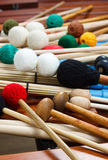 Pile of coloured mallets and sticks. A pile of coloured mallets and a pair of unplugged drum sticks Royalty Free Stock Photos