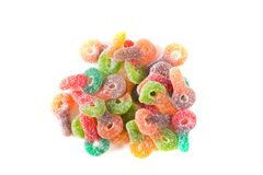 Colorful sugar coated chewy gummy candy. Pile of colourful sugary coated chewy gummy candy royalty free stock photo
