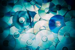Pile of Compact Discs. Photo Background. Vintage Technology Backdrop Stock Image