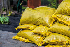 Pile of compost to fertilize. Heap of sacks with compost stock photo