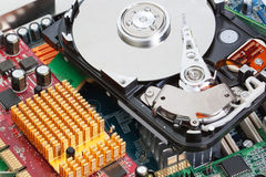 A pile of computer parts motherboard hard drive. royalty free stock photo