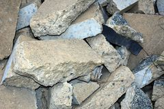 Pile of concrete blocks following demolition. Broken concrete pile of rubble from demolition background royalty free stock image