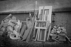 Pile of construction debris. Construction debris dumped at the house wall by workers. Black and white photo royalty free stock photos