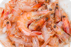 Pile of cooked and peeled shrimp. Detail of the heads and eyes of this seafood. Wastes from cleaning cooked Shrimps Stock Photography