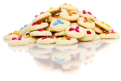 Pile of cookies. With smarties on white with reflections Royalty Free Stock Photos