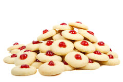 Pile of cookies with cherries. Isolated on white Stock Photography