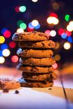 Pile of cookies. Colorful lights in the background. Smells like Christmas Stock Images