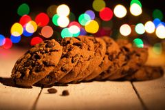 Pile of cookies. Colorful lights in the background. Smells like Christmas Royalty Free Stock Images