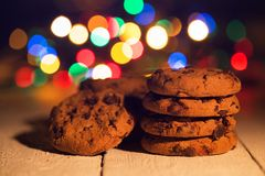 Pile of cookies. Colorful lights in the background. Smells like Christmas Royalty Free Stock Image