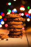 Pile of cookies. Colorful lights in the background. Smells like Christmas Stock Image