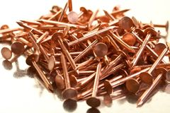 Pile of copper nails. On a galvanized steel table Royalty Free Stock Photos