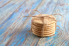 Pile of corded cookies on wooden background Royalty Free Stock Photo