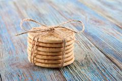Pile of corded cookies on wooden background Stock Images