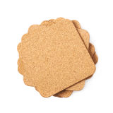 Pile of cork textured coasters isolated Royalty Free Stock Photos