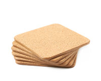 Pile of cork textured coasters isolated Stock Images