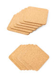 Pile of cork textured coasters isolated Stock Photo