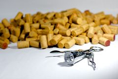 Pile of Corks. A pile of corks behind a corkscrew  on a white background Stock Photography