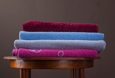 Pile of cotton Colorful towels. On a table Royalty Free Stock Image