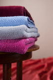 Pile of cotton Colorful towels. On a table Royalty Free Stock Photography