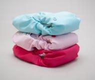 Pile couleurs de couches-culottes de tissu de différentes Photographie stock libre de droits