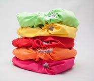 Pile couleurs de couches-culottes de tissu de différentes Photos libres de droits
