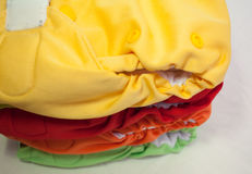 Pile couleurs de couches-culottes de tissu de différentes Photo libre de droits