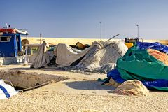 Pile of covered with colored sheets fishing nets. stock photos