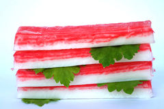 Pile of crab sticks and celery  leaf  on white background Stock Images