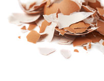 Pile of cracked egg shells isolated Stock Photos