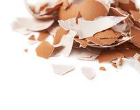 Pile of cracked egg shells isolated Stock Photos