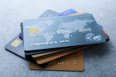 Pile of credit cards on table. Closeup stock image