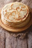Pile of crepes on a board on the table. Vertical top view Royalty Free Stock Photography