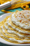 Pile of crepes with cottage cheese and grated coconut Stock Photos