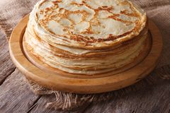 Pile of crepes on a kitchen board on the table. horizontal Royalty Free Stock Photo
