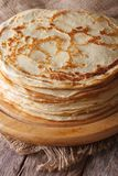 Pile of crepes on a kitchen board on the table. Vertical Royalty Free Stock Images
