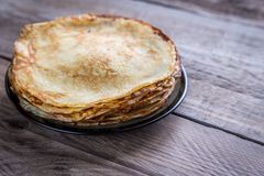 Pile of crepes on the wooden table Stock Image