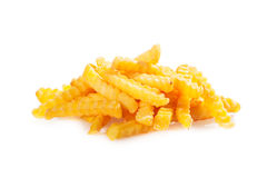 Pile of crinkle cut fried potato chips Royalty Free Stock Images