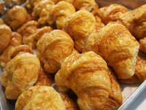 Pile of croissants in on shelf in bakery or baker`s shop. Photo of pile of croissants in on shelf in bakery or baker`s shop Stock Images