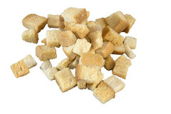 A pile of croutons. Isolated on a white background stock photo