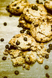 Pile of Crumbled Chocolate Chip Cookies on Table Stock Images
