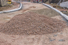 Pile of crushed gravel on road construction site Royalty Free Stock Photo