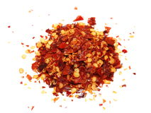 Pile crushed red pepper, dried chili flakes and seeds isolated on white Royalty Free Stock Image