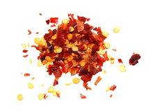 Pile crushed red pepper, dried chili flakes and seeds isolated on white Stock Photography