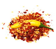 Pile crushed red pepper, dried chili flakes and seeds  on white Royalty Free Stock Photos