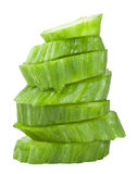 Pile of cucumber slices isolated over white. Stock Image