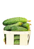 Pile of cucumber in a veneer basket isolated Royalty Free Stock Photography