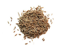 Pile of cummin seeds. Pile of raw cummin seeds on white Royalty Free Stock Photography