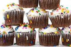Pile of cup cakes. Pile of chocolate cup cakes with white frosting Royalty Free Stock Photos