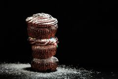 A pile of cup cakes on a black background. A pile of cakes on a black background Stock Images