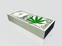 Pile of currency and marijuana leaf Royalty Free Stock Photos